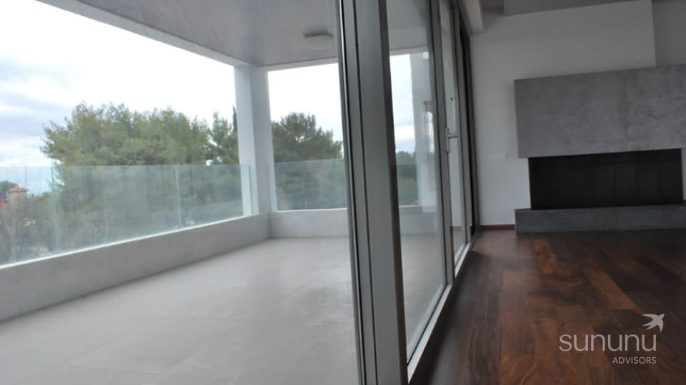 Large terrace adjoining living area of apartment in Glyfada