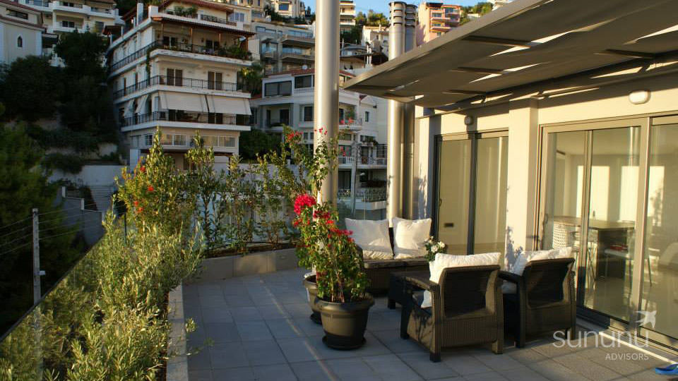 Voula maisonette terrace with planters and seating