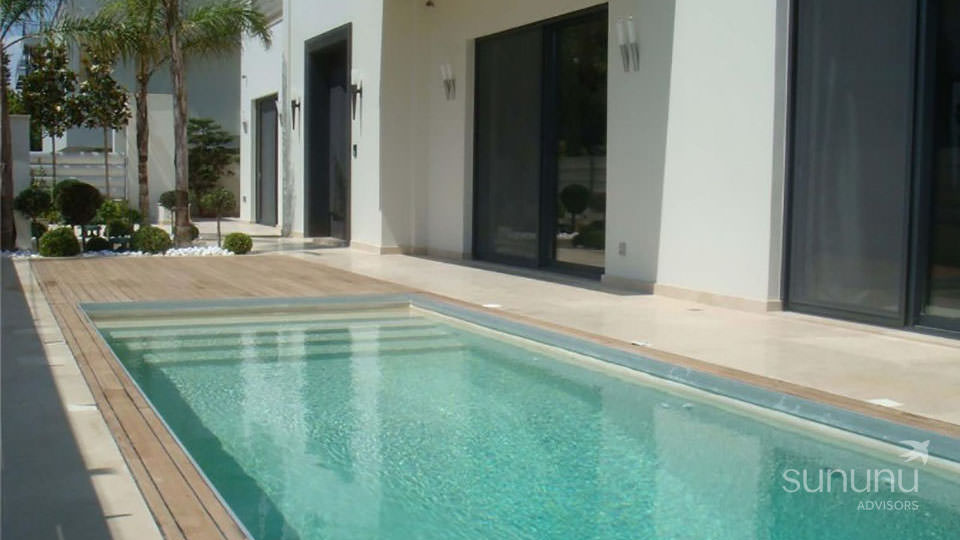 Swimming pool of modern home in Voula