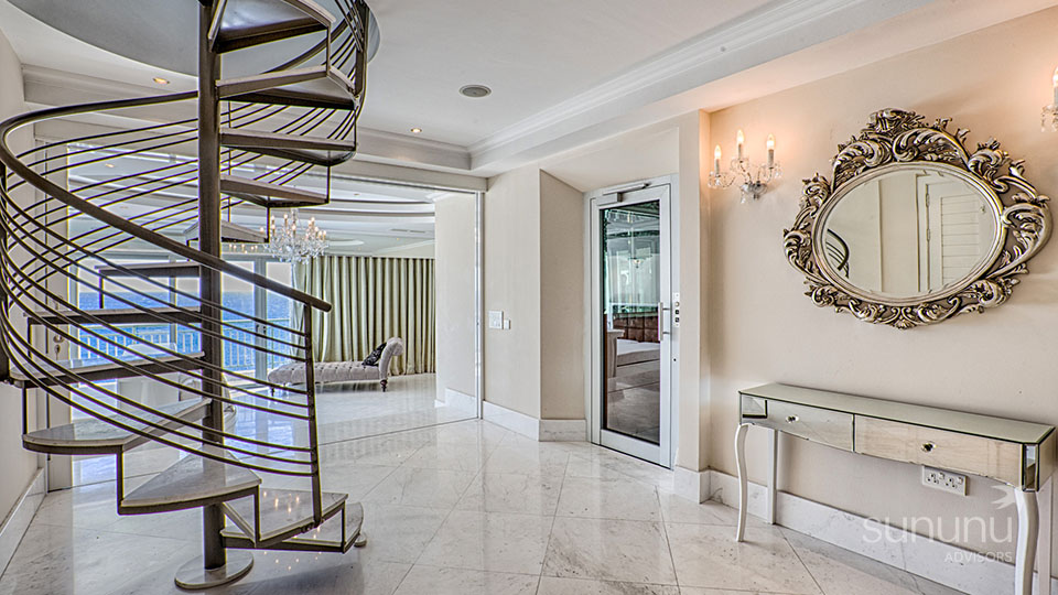 Exquisite spiral staircase and vintage accents of duplex penthouse in Portomaso