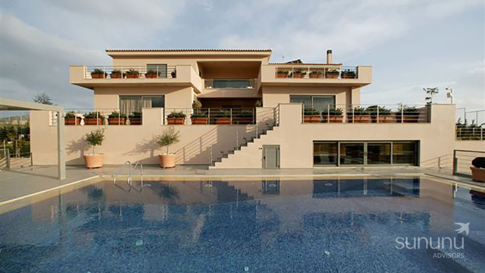 Stately exterior and pool of villa in Agia Marina