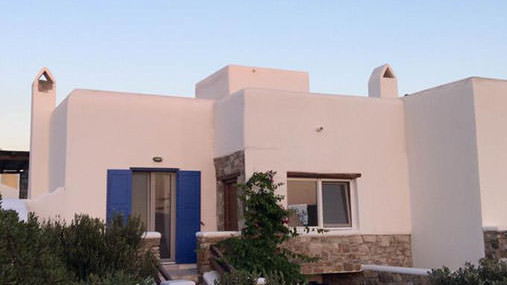 Exterior and gardens of airy maisonette in Mykonos