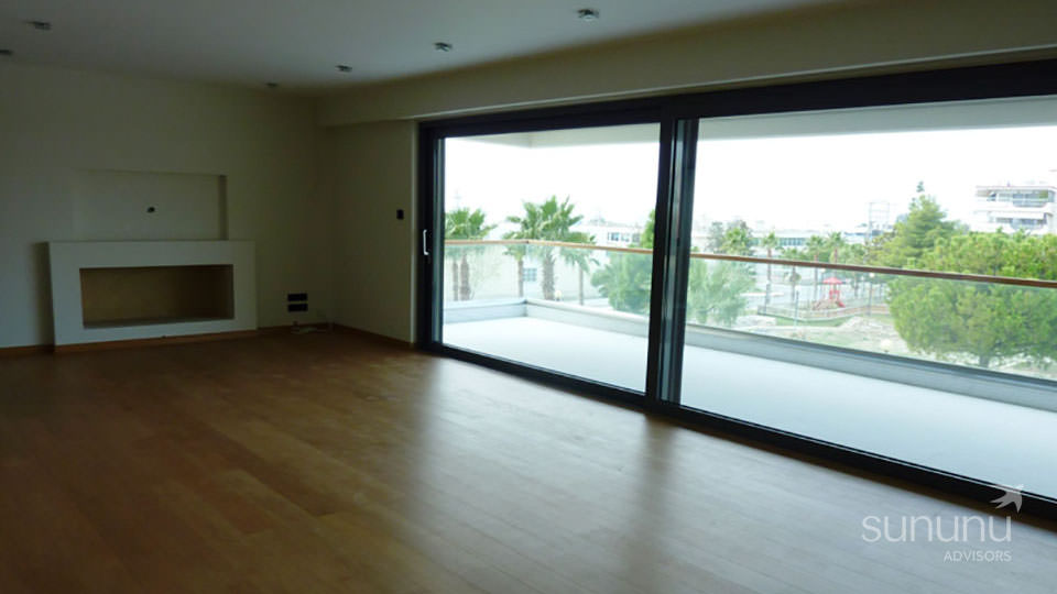 Beautifully finished living room and balcony of apartment in Elliniko