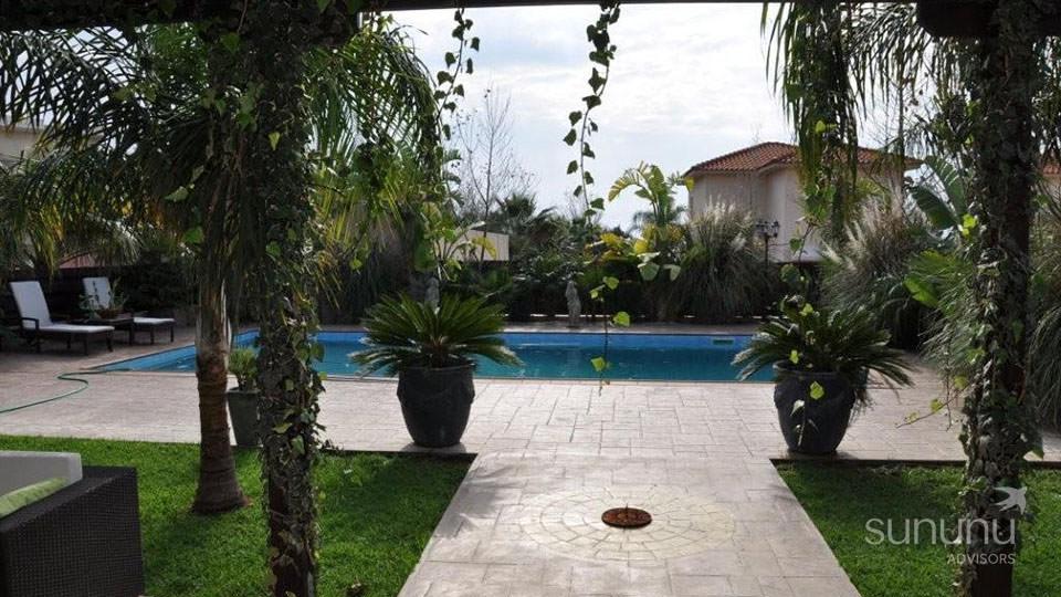 Charming gardens around beach access villa in Zygi
