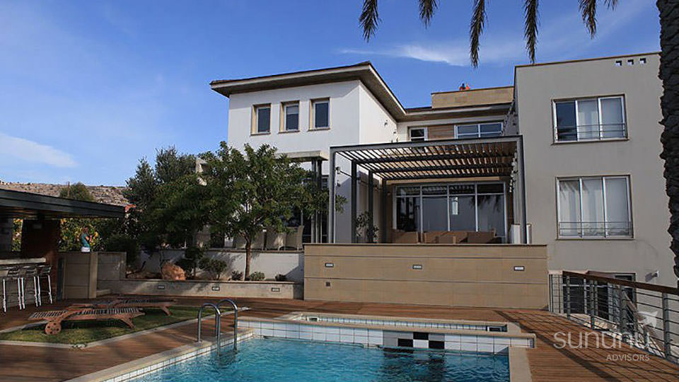 Stylish landscaping and exterior finishes of villa in Paphos