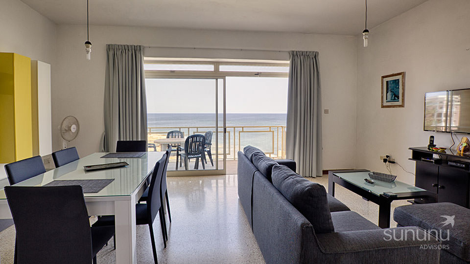 Spacious sea facing living/dining area of apartment in St. Julian's