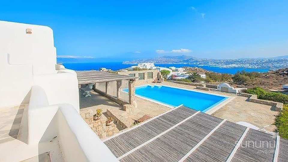View of pool, grounds and the open sea from lovely villa in Mykonos