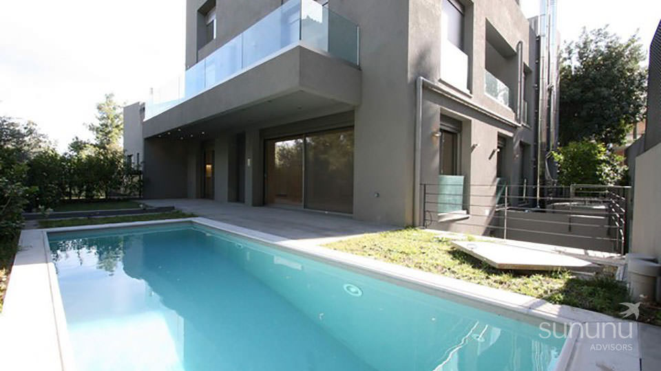 Contemporary exterior and pool of Psychiko maisonette in Athens