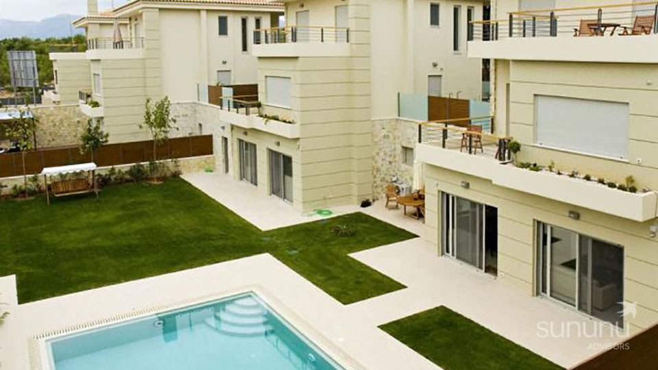 Exterior of modern maisonette in Athens, overlooking a pool and garden