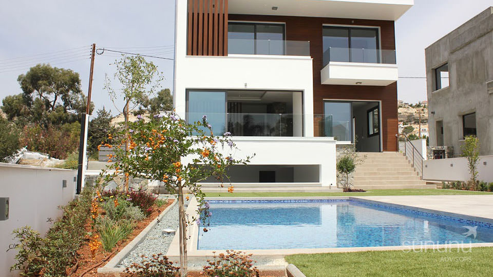 New villa in Limassol with a stylish elevation and pool area