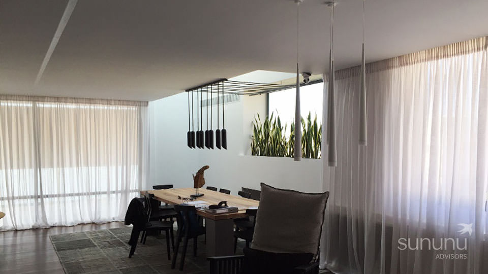 Dreamy dining area with sheer curtains in maisonette in Glyfada