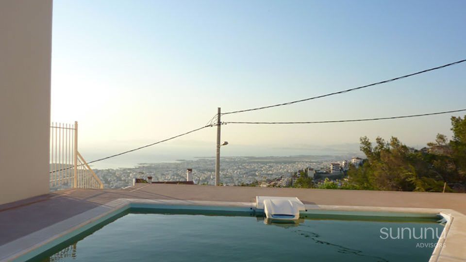 Panoramic views from swimming pool of sea facing maisonette in Voula