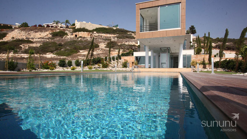 Secluded Sea Caves setting and infinity pool of villa in Peyia