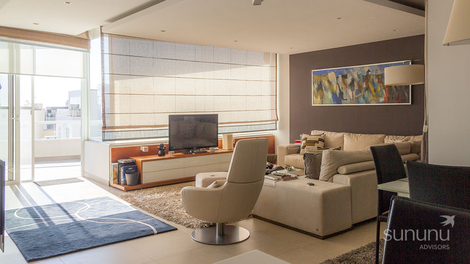Elegant daylit living room of penthouse in Ibrag