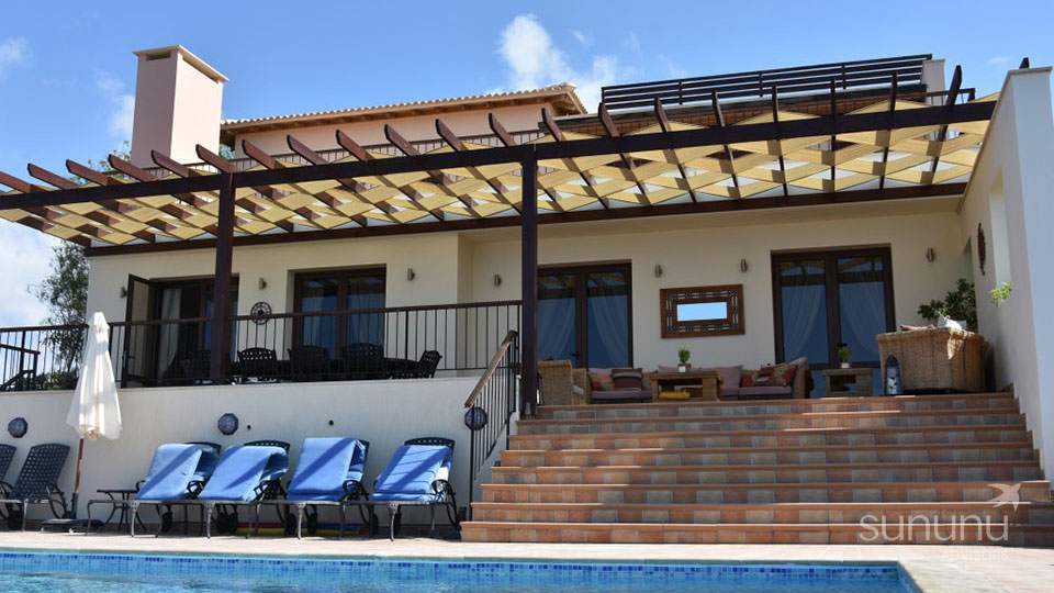 Elegant patio of villa in Kouklia leads down to its heated pool